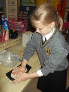 Putting the bread into the  bread tin