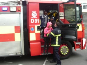 A helping hand getting of the fire truck